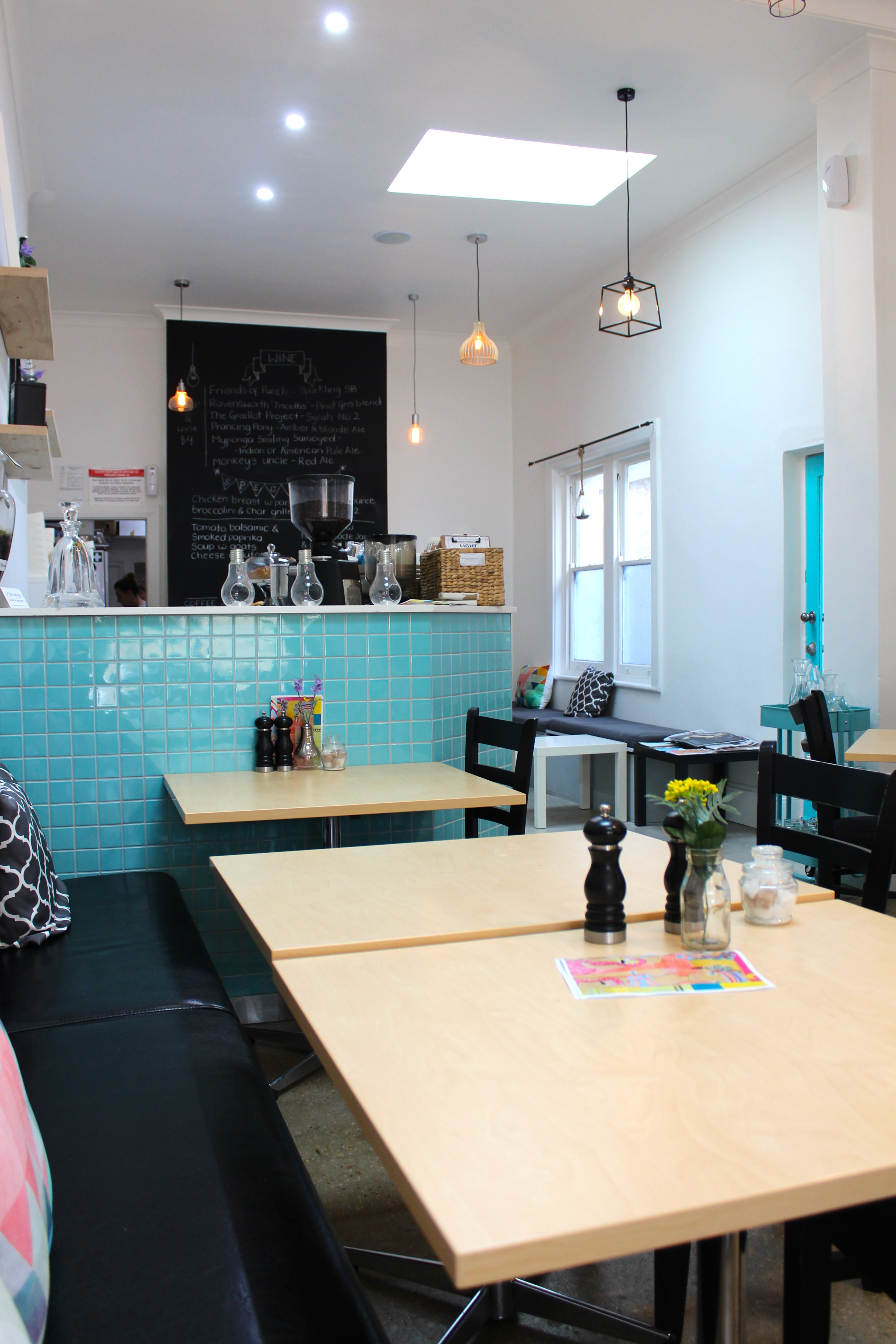 the dcor at the lightbulb caf is fresh and modern with a generous splattering of bright artwork to admire whilst sipping a coffee and chatting with your